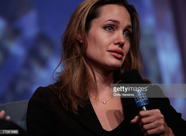 Actress Angelina Jolie tears up while telling a refugee's story during a panel discussion about education at the Clinton Global Inititative annual...