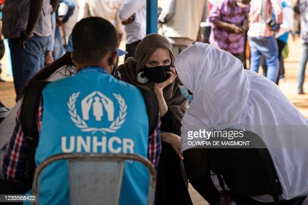 Actress Angelina Jolie, United Nations High Commissioner for Refugees special envoy, speaks with Malian refugees in Goudebou, a camp that welcomes...