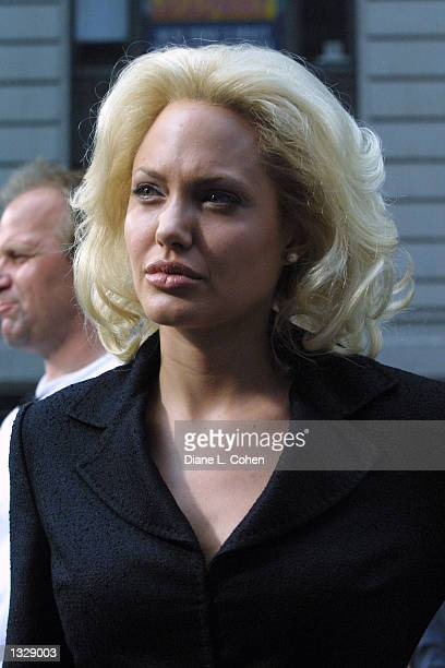 Actress Angelina Jolie waits during filming on the set of the movie 'Life or Something Like It' June 30 2001 in Times Square in New York City Jolie...