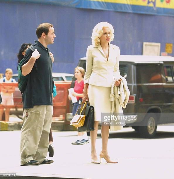 Actress Angelina Jolie waits during filming on the set of the movie 'Life or Something Like It' July 1 2001 in Times Square in New York City Jolie...