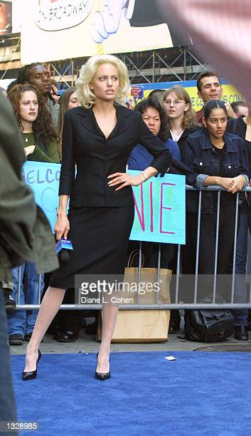 Actress Angelina Jolie waits while filming a scene on the movie set of 'Life or Something Like It' June 30 2001 in Times Square in New York City...