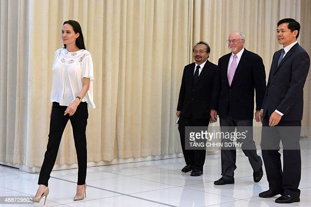 US actress Angelina Jolie walks during a meeting with Cambodian Prime Minister Hun Sen at the Peace Palace in Phnom Penh on September 17 2015...