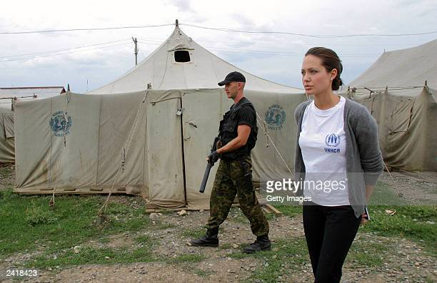Actress Angelina Jolie walks in 'Bella' refugee camp during her visit in Ingushetia August 22 2003 in Ingushetia Russia Jolie a Goodwill Ambassador...