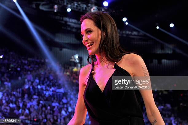 Actress Angelina Jolie walks off stage after accepting the Favorite Villain for 'Maleficent' onstage during Nickelodeon's 28th Annual Kids' Choice...