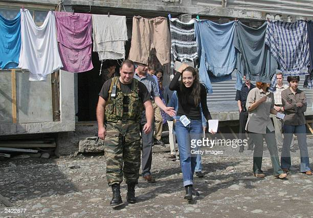 Actress Angelina Jolie walks thru a refugee camp August 23 2003 near Vladikavkaz Osetia Jolie who is in Russia as a goodwill ambassador for the UN...