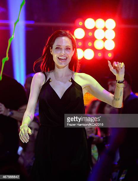 Actress Angelina Jolie walks to stage to accept award for Favorite Villain in 'Maleficent' at the Nickelodeon's 28th Annual Kids' Choice Awards at...