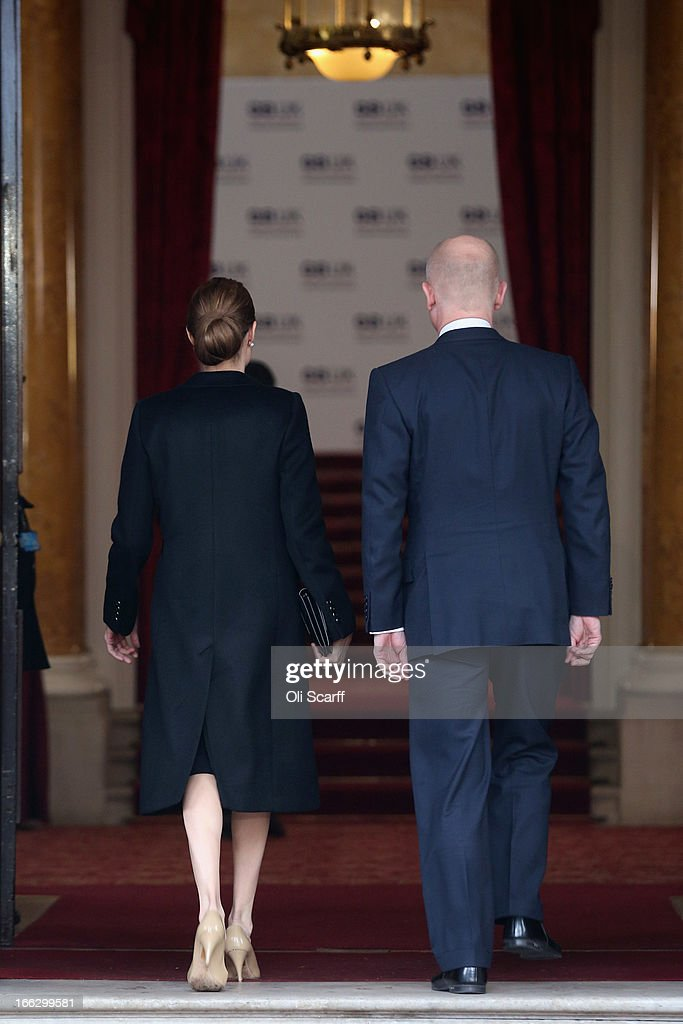 Actress Angelina Jolie walks with British Foreign Secretary William Hague into Lancaster House before attending the G8 Foreign Ministers' conference on April 11, 2013 in London, England. G8 Foreign Ministers are holding a two day meeting where they will discuss the situation in the Middle East; including Syria and Iran, security and stability across North and West Africa, Democratic People's Republic of Korea and climate change. British Foreign Secretary William Hague will also highlight five key policy priorities.