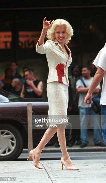 Actress Angelina Jolie waves to fans during a break in filming on the set of the movie 'Life or Something Like It' July 1 2001 in Times Square in New...