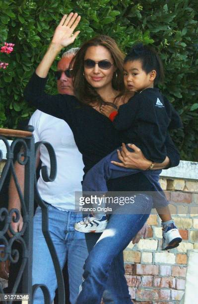Actress Angelina Jolie with her son Maddox waves after arriving at Cipriani Hotel for the 61st Venice Film Festival on September 6 2004 in Venice...