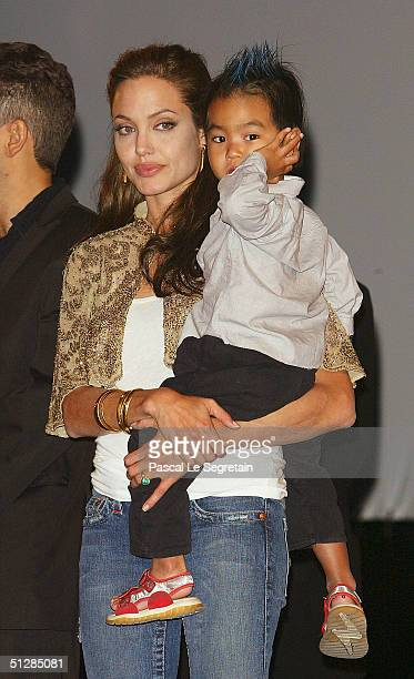 Actress Angelina Jolie with son Maddox attend the World Premiere of Shark Tale in San Marco Square as part of the 61st Venice Film Festival on...