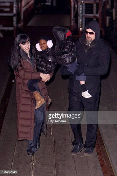 Actress Angelina Jolie Zahara JoliePitt Shiloh JoliePitt and actor Brad Pitt leave the Salt film set at Pier 66 on December 29 2009 in New York City