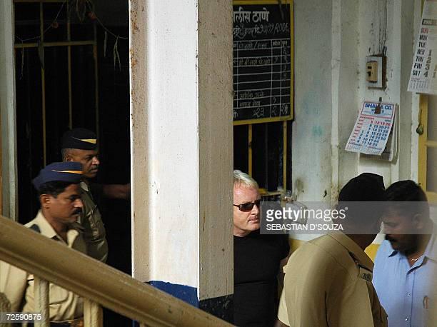 US actress Angelina Jolie's bodyguard Michael John Brett waits at the Azad Maidan Police Station soon after his arrest in Mumbai17 November 2006...