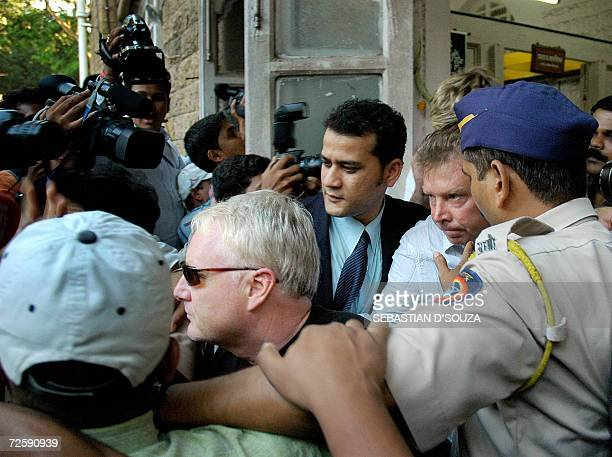 US actress Angelina Jolie's bodyguards Michael John Brett and Robert Patrick Dunn leave the Azad Maidan Police Station soon after they were granted...