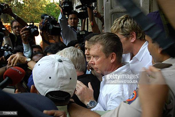 US actress Angelina Jolie's bodyguards Robert Patrick Dunn and Tomas McAdanc leave the Azad Maidan Police Station soon after they were granted bail...