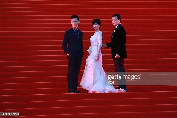 Actress Angie Chiu and her husband actor Melvin Wong walk the red carpet during the closing ceremony of the 5th Beijing International Film Festival...
