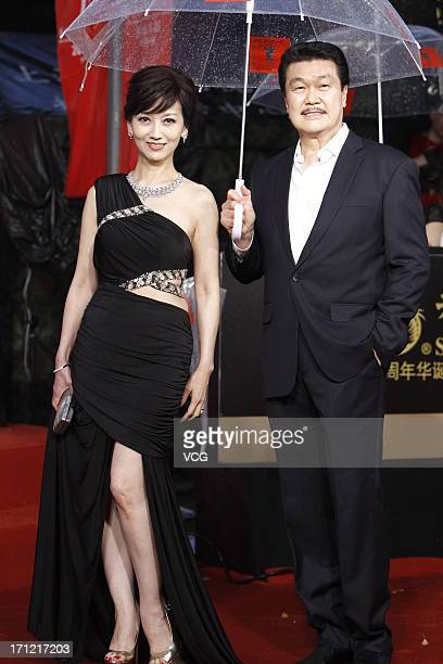 Actress Angie Chiu and her husband Melvin Wong arrive at the closing ceremony of 16th Shanghai International Film Festival at Shanghai Culture Square...