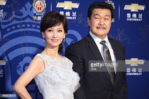 Actress Angie Chiu and her husband Melvin Wong pose on the red carpet during 17th Huading Awards on August 9 2015 in Shanghai China