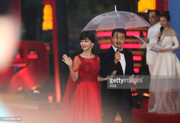 XI'AN CHINA OCTOBER 13 Actress Angie Chiu and husband Melvin Wong pose on the red carpet during the closing ceremony of the 5th Silk Road...