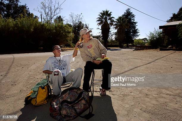 Actress Angie Dickenson and her daughter Nikki Bacharach of Los Angeles sit in the parking lot of the Parkfield Inn hoping to feel aftershocks on...