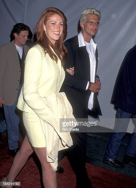Actress Angie Everhart and Actor Ashley Hamilton attend the Mission Impossible Westwood Premiere on May 20 1996 at Mann Bruin Theatre in Westwood...