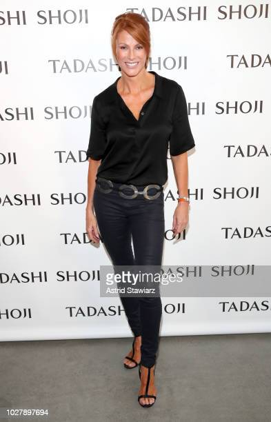 Actress Angie Everhart poses backstage before the Tadashi Shoji show during New York Fashion Week The Shows at Gallery I at Spring Studios on...