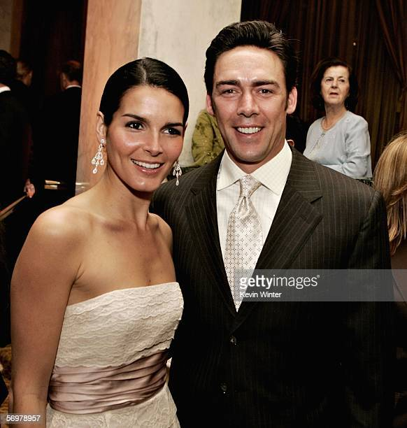 Actress Angie Harmon and actor Jason Sehorn speak during the EIF's Women's Cancer Research Fund honoring Melissa Etheridge at Saks Fifth Avenue's...