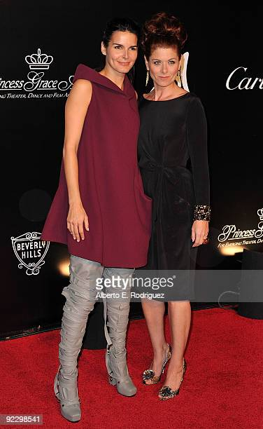 Actress Angie Harmon and actress Debra Messing arrive at the Rodeo Drive Walk of Style Award honoring Princess Grace of Monaco and Cartier on October...