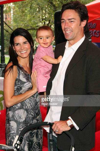 Actress Angie Harmon her daughter Emery Hope Sehorn and husband football player Jason Sehorn attend Huggies Little Movers Adventure Zone And Live...