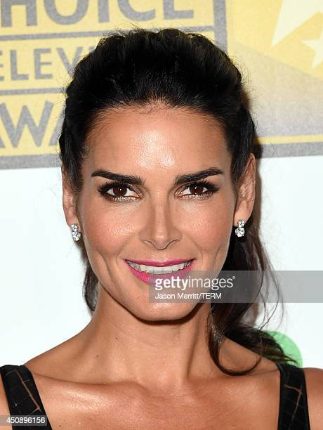 Actress Angie Harmon poses in the press room during the 4th Annual Critics' Choice Television Awards at The Beverly Hilton Hotel on June 19 2014 in...