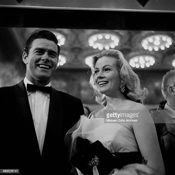 Actress Anita Ekberg and Jeff Richards attend the premier of 'Not as a Stranger' in Los Angeles California