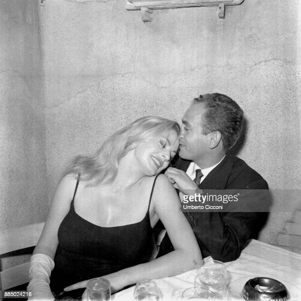 Actress Anita Ekberg is with the photographer Angelo Frontoni at the restaurant 'Rugantino' during a dinner party Rome 1958