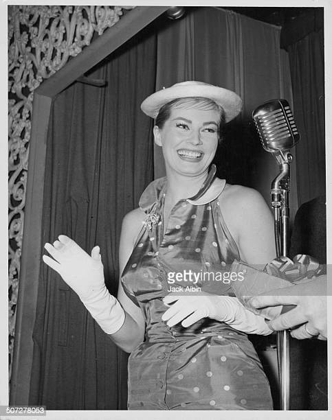 Actress Anita Ekberg on stage at the Hollywood Women's Press Club Luncheon to receive a prize circa 1960