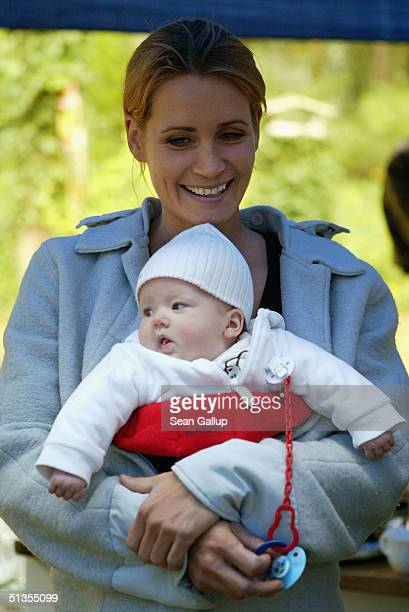 Actress Anja Kling and her baby daughter Alea Jolie attend a social event September 24, 2004 in Wilhelmshorst near Potsdam, Germany.
