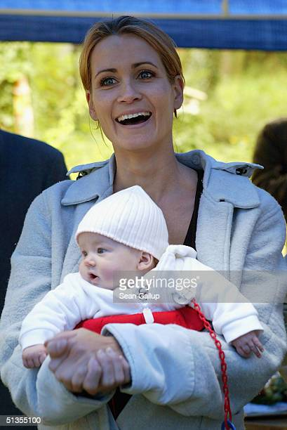 Actress Anja Kling and her baby daughter Alea Jolie attend a social event September 24 2004 in Wilhelmshorst near Potsdam Germany