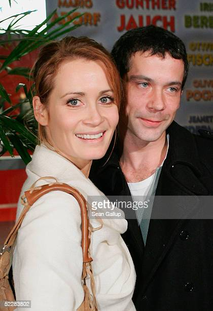 Actress Anja Kling and her husband Jens Solf attend the German premiere of Racing Stripes on March 6 2005 in Berlin Germany