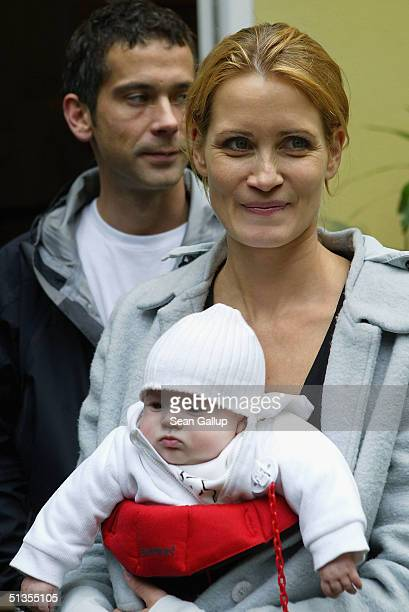 Actress Anja Kling her husband Jens Solf and their baby daughter Alea Jolie attend a social event September 24 2004 in Wilhelmshorst near Potsdam...