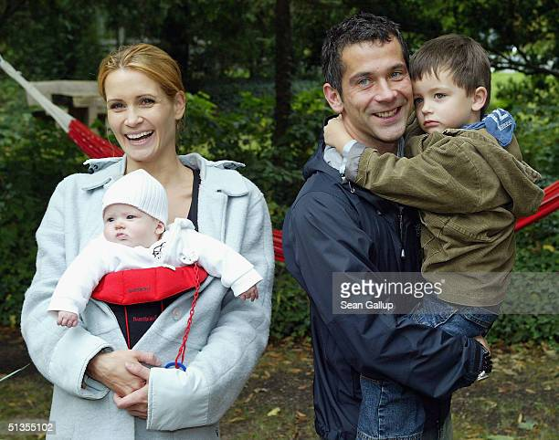 Actress Anja Kling her husband Jens Solf their baby daughter Alea Jolie and their son Tano attend a social event September 24 2004 in Wilhelmshorst...