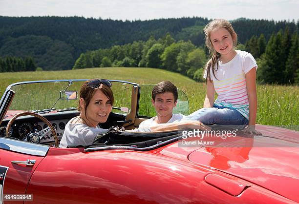 Actress Anja Kling her son Tano and daughter Alea sit in a Jaguar E-Type during the Ralley One on May 31, 2014 in Durbach, Germany.