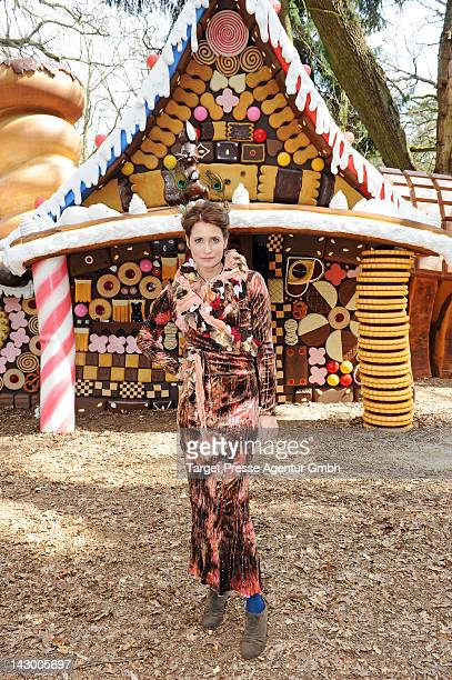 Actress Anja Kling poses during a ARD set visit in front of of the witch's cottage built for the screen adaptation of the 'Haensel und Gretel'...