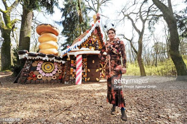 Actress Anja Kling poses during a ARD set visit in front of the witch's cottage built for the screen adaptation of the 'Haensel und Gretel' fairytale...