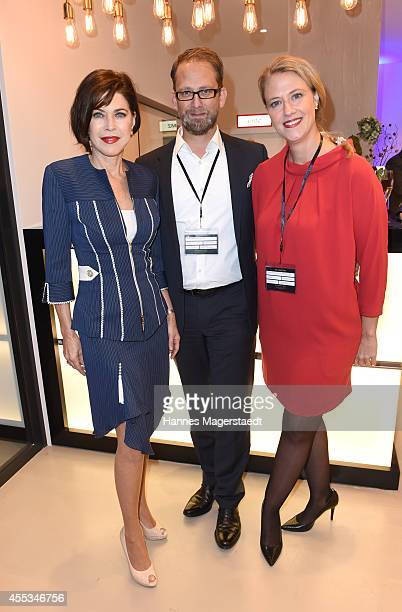 Actress Anja Kruse Alexander Winter and Christiane WinterThumann attend the Arcona Living Munich Opening on September 12 2014 in Munich Germany