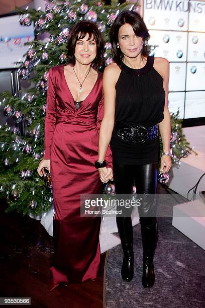 Actress Anja Kruse and actress Gerit Kling pose in front of a christmas tree at the launch of the BMW art advent calender 2009 at a BMW branch on...
