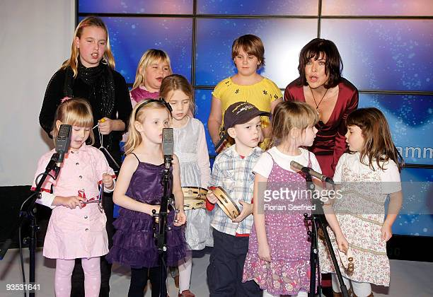 Actress Anja Kruse and children perform christmas songs on stage at the launch of the BMW art advent calendar 2009 at a BMW branch on December 1,...