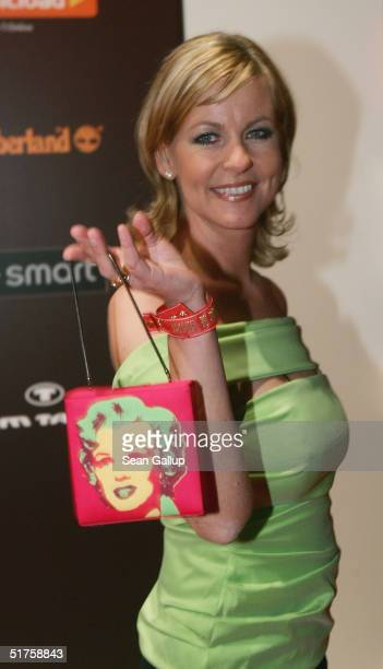 Actress Anja Schuete arrives with an Andy Warhol Marilyn Monroe handbag at the Tribute To Bambi Charity Gala on November 17 2004 in Hamburg Germany