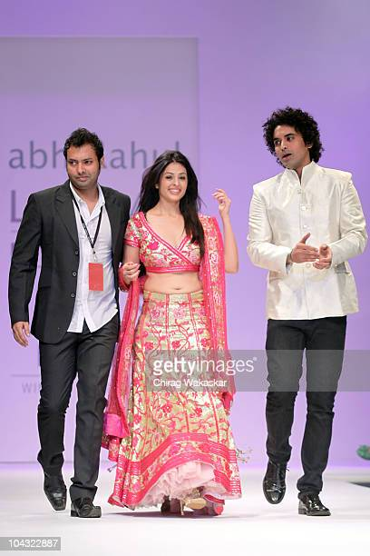 Actress Anjana Sukhani walks the runway with designers Abhi Rahul at the Lakme Fashion Week Winter Festive 2010 Day 5 at the Grand Hyatt on September...