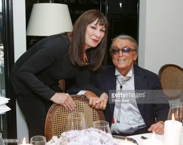Actress Anjelica Huston and producer Robert Evans attend VIOLET GREY Honors Elizabeth Taylor At She's So Violet Salon Dinner on February 26 2014 in...