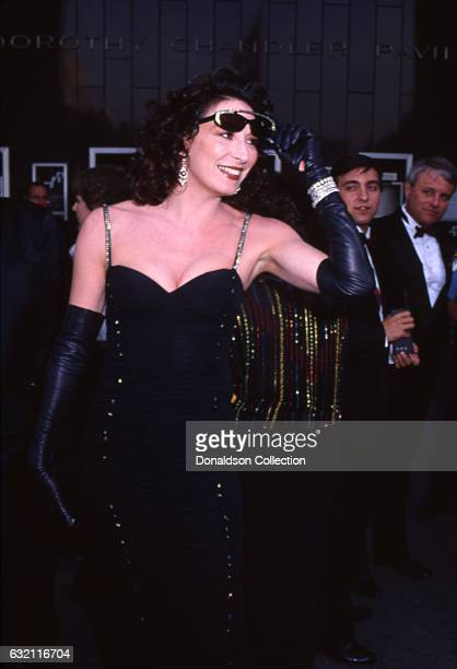 Actress Anjelica Huston attends the Academy Awards at the Dorothy Chandler Pavilion in March 1987 in Los Angeles California