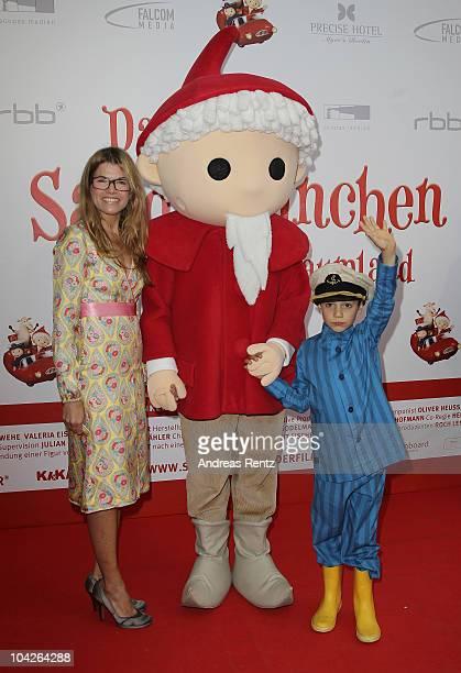 Actress Anke Engelke Sandmaennchen figure and main actor Bruno Renne arrive at the Das Sandmaennchen premiere on September 19 2010 in Berlin Germany...