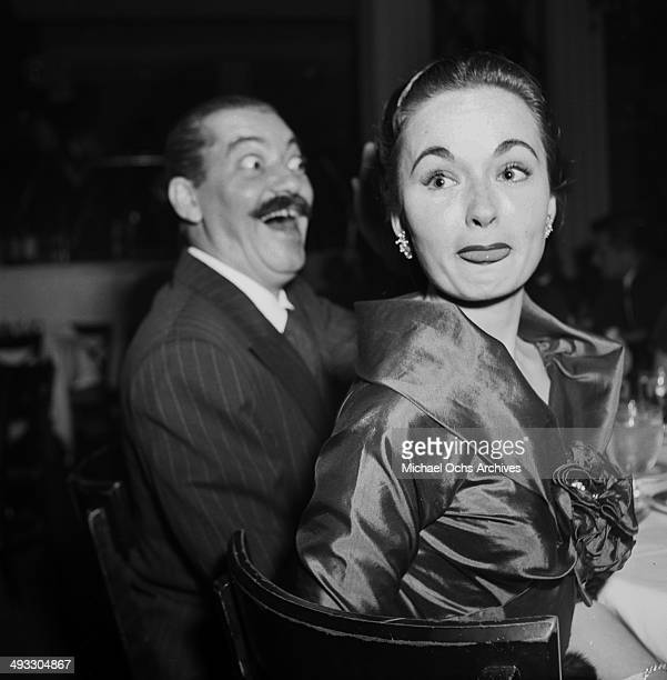 Actress Ann Blyth attends the Emmy Awards next too actor Jerry Colonna in Los Angeles California