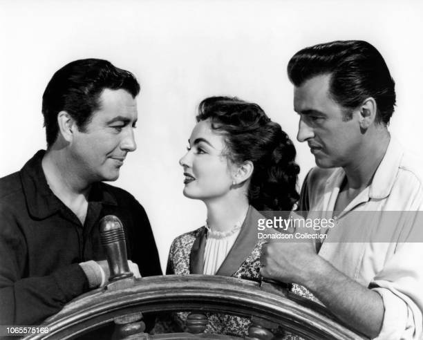 Actress Ann Blyth Robert Taylor and Stewart Granger in a scene from the movie 'All the Brothers Were Valiant'